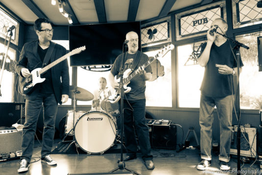 The Stan Zabek Band performs at Durty Nelly's pub. Drew Todd, Lee Campbell, Randy Davis, and Stan Zabek (left to right).